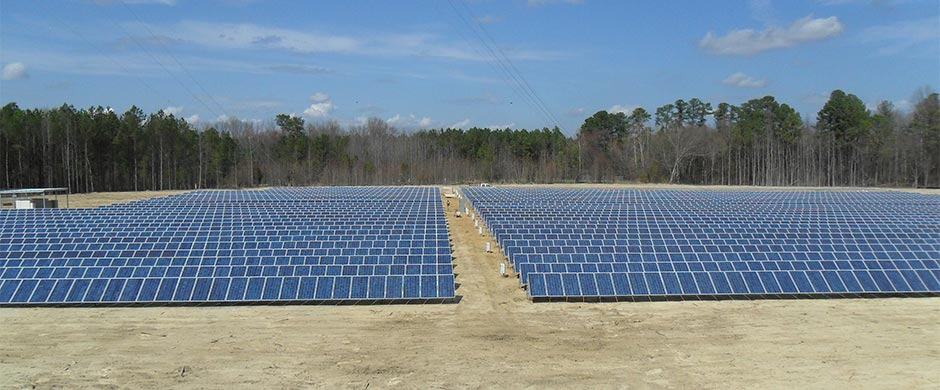 North Carolina solar installation photo showing aisle between two separate solar fields of approximately 1.2 Mega Watts of solar panels.