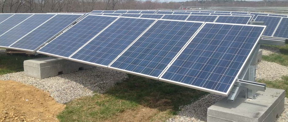 Brookfield solar installation in Massachussetts. Solar panels mounted with racking onto concrete ballast Blocks